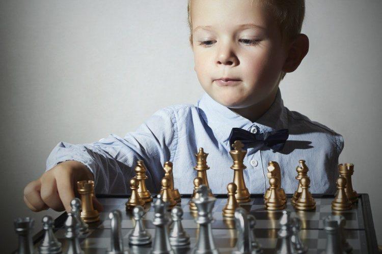 smart kid playing chess