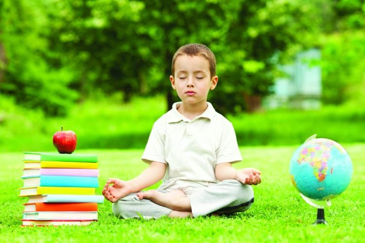Beautiful child in zen meditation